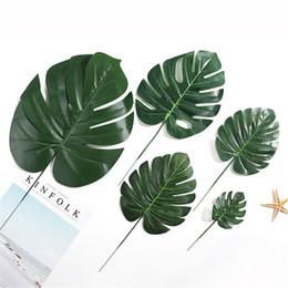 China Cheap Plastic Flowers Artificial fake Monstera palm Leaves green plants wedding DIY decoration arrangement plant leaf 4 Size supplier cheap red white wedding decorations suppliers