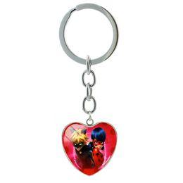 $enCountryForm.capitalKeyWord NZ - TAFREE Exquisite key chain Cartoon love's keychain about Ladybug &Black Cat Noir key chain Glass keychain jewelry LB77