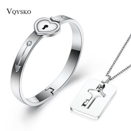 6fb2812d31 A Couple Jewelry Sets Stainless Steel Love Heart Lock Bracelets Bangles Key  Pendant Necklace Couples C19041701