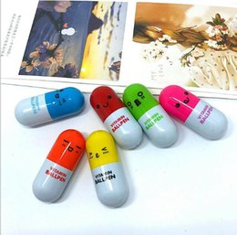 $enCountryForm.capitalKeyWord Australia - New hot retractable creative stationery cute expression capsule pill ballpoint pen
