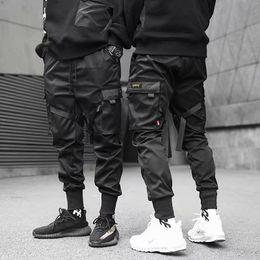 Wholesale casual black pockets trousers for sale – dress Cargo pants Men Casual Joggers Pants Solid Male Multi pocket Trousers New Mens Sportswear Hip Hop Harem Pencil