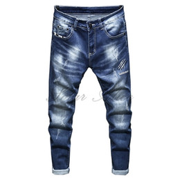 Free Shipping 2020 Men's Four Seasons New Little Feet Jeans White High-end Slim Blue Casual Pants Claw Pencil Pants
