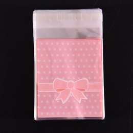 $enCountryForm.capitalKeyWord Australia - 100pcs bag OPP Plastic package bag Lovely Pink or Blue Bow Design gift Packages Candy Pack paper