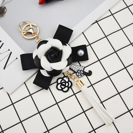 $enCountryForm.capitalKeyWord Australia - Genuine Leather Black&White Male&Female Keychain Bag Plush Car Key Ring Car Key Camellia Flower Hat Tassel Style Key Chain