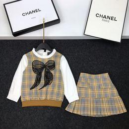 $enCountryForm.capitalKeyWord Australia - Girls skirts sets kids designer clothing bow tops + skirts 2pcs autumn shirt sleeves stitching plaid design cotton sets