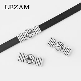 carving shell jewelry NZ - 5sets Antique Silver Carved Shell Pattern Flat Magnetic Clasp For 10*2mm Flat Leather Cord Bracelet Jewelry Making Findings