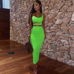 fashion skirt set Canada - Women Summer Fashion 2020 2Pcs Set Crop Top Sexy Hollow Out Buttock Skirts Green Orange Two Piece Outfits Sexy Sets Ladies Wear T200528