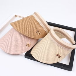 China 2019 New Woman's Sun Hats Hand Made DIY Straw Bowknot Visor Caps Parent-Child Summer Cap Casual Shade Hat Empty Top Hat Beach supplier hands free visor suppliers