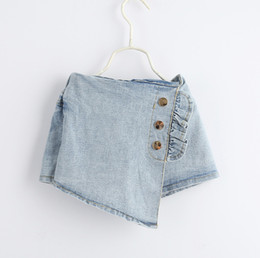 Hottest Girl Short Pants NZ - Fashion kids hot jean shorts summer girls ruffle three buckle elastic denim shorts children double pocket irregular cowboy short pants F5407
