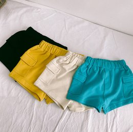 Japan Clothes Wholesalers Australia - INS Boys shorts kids double pocket elastic waist shorts children candy color casual shorts summer new baby boy clothes F7504