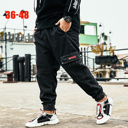 Big Denim Australia - 2019 Trend Black Harem Jeans Men 36-48 Big size Male denim jeans Pants Striped Cargo Pockets Fashion Plus size men Harem pants