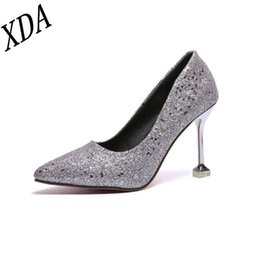 Golden Pink Shoes NZ - Designer Dress Shoes XDA Pumps 2019 Fashion High Heel Hollow Pointed sequins Grind arenaceous women black pink golden silver W34