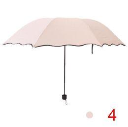 Sun Plastic Coating Australia - Umbrellas tri-fold umbrella Wave sunshade high quality Sunscreen black plastic Folding umbrella Creative arched sun umbrellas