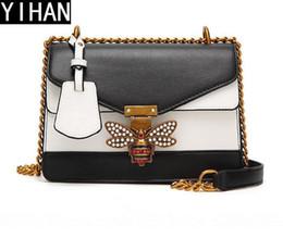Color Leather Bags Australia - Factory independent brand handbag fashion hit color bee woman chain bag elegant hit color leather Messenger shoulder bag trend leather clutc