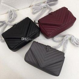 $enCountryForm.capitalKeyWord Australia - New leather handbag, famous designer handbag, goat leather bag, hand-embroidered V line, 20cm 1886 high quality Slanted straddle carrier bag