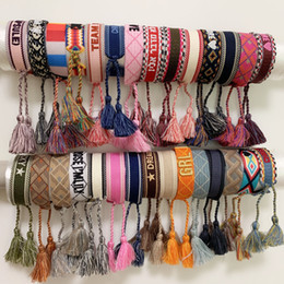 Bracelet weaves online shopping - Luxury style rope material woven bracelet with sewing words and tassel hand strap brand jewelry for women gift