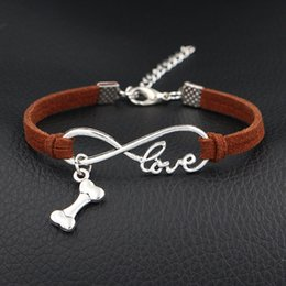 $enCountryForm.capitalKeyWord NZ - 2019 New Silver Color Fashion Elegant Infinity Love Bone Shape Pendant Bracelet Bangles Dark Brown Leather Suede Rope Women Men Jewelry Gift