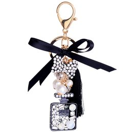 $enCountryForm.capitalKeyWord NZ - Newest High quality Pearl Crystal bow tie silk tassel perfume bottle keychain 5.7inch keyrings lady girls bag car pendant fashion accessorie