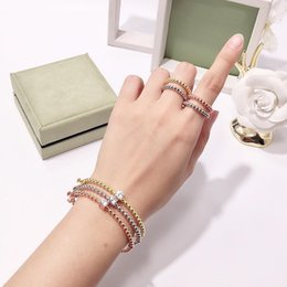 brass plating rings NZ - Simple Fashion Golden Beads Brass Four Leaf Clover Ring for Women Classic Fashion Designer Brand Jewelry Woman