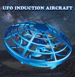 Venta al por mayor de Mini UFO Drone Toys Control por infrarrojos Control de aviones interactivo Inducción Altitud controlada Mantener Quadcopter para niños