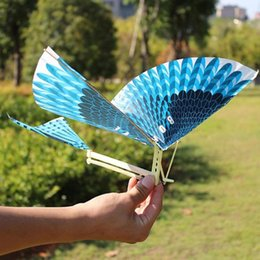 Discount flying bird toy wholesale - Elastic Rubber Band Powered Flying Birds Kite Funny Kids Interactive Toy Gift Outdoor Fun & Sports Flying Bird Kites