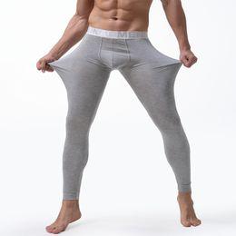 Wholesale long johns warm winter pants resale online - Winter Thermal Underwear Men Long Johns Stretch Warm Thermo Underwear Brand Mens Warm Pants For Winter Clothes Men Leggings XL Y200106