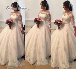 Wholesale Beaded Arabic Lace Wedding Dresses Bateau Sheer Long Sleeves Ball Gown Bridal Dresses Princess Wedding Gowns Formal Dresses