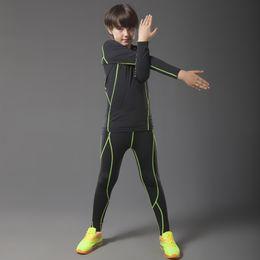 Venta al por mayor de New Boy Camiseta de compresión para niños Capa base Trajes de running Manga larga de alta calidad Flexible Deporte Fitness Niños Ropa # 687790