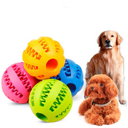 Venta al por mayor de Juguetes para perros de bola de masticación de goma juguete de entrenamiento Cepillo de dientes de juguete Masticar bolas de comida Producto mascota Producto Drop Ship 360061