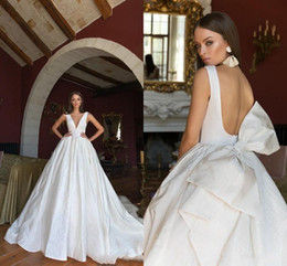 Wholesale black dresses big skirts for sale – plus size Vintage Open Back A line Wedding Dress Elegant Big Bow Satin Deep V Neck Long Bohemain Beach Boho Brodal Gown