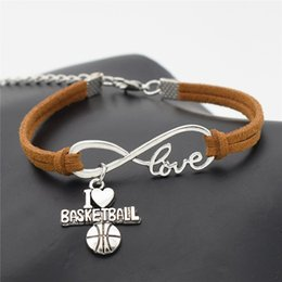 football pendants NZ - Hot Vintage Infinity Love Basketball Soccer Volieyball Baseball Football Pendant Bracelet Women Men Couples Brown Leather Suede Rope Jewelry