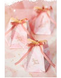 $enCountryForm.capitalKeyWord UK - 50pcs lot Shaped Wedding Favor and Gifts 6*6*8.5cm Baby Shower Paper Candy Box Wedding Favors Pink Sweet Gifts Bags Supplier
