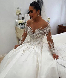 sheer crystals gowns Australia - 2020 New Sexy Ball Gown Wedding Dresses Sheer Neck Long Sleeves Illusion Crystal Beaded Satin Sexy Back Chapel Train Plus Size Bridal Gowns