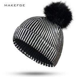 57261a6f2 2019 New Knit Black Fur Pompom Hat Gold and Silver Metallic Shiny Warm  Beanie Hats for Women Outdoor Ponytail Beanie Women s Hat