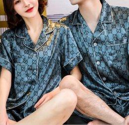 Luxury designer pyjamas couples pajamas women summer thin short-sleeved ice Silk simulation men's Health Net red wind home service suit on Sale