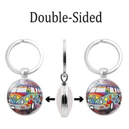 Glasses Trade Australia - Foreign trade new accessories Anti-war peace time gem double-sided resin glass keychain key ring Silver alloy pendant pendant wholesale