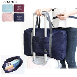 Storage Packs Australia - wholesale Hot Casual Large Capacity luggage Packing Tote Shoulder Travel Shopping Big Bag Folding Clothes Storage Pouch