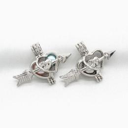 07b40265298d 10 unids Cupid s Love Arrow Pearl Cage colgante Perfume medallones de  aceite Difusor Encantos del collar para Oyster Pearl Jewelry