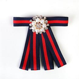 Imitation Clothing NZ - Tide Brand Imitation Pearl Female Pins Fashion Diamond Ribbon Tassel Lady Brand Brooches Party Clothing Accessories Trendy Brooch