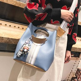 Chinese  Women Pu Leather Bucket Shoulder Bags With Pendant Wide Guitar Strap Handbag Messenger Bag Fa$3 Women Bag manufacturers