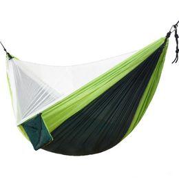 Venta al por mayor de 4 colores 270 * 140cm Hamaca de mosquitera fácil de configurar Hamacas dobles con clavos de cuerda de viento Muebles de exterior Muebles de campamento CCA11663 10 piezas