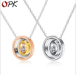 Necklaces Pendants Australia - Fashion new three-color three-ring interlocking pendant diamond-studded titanium steel couple necklace