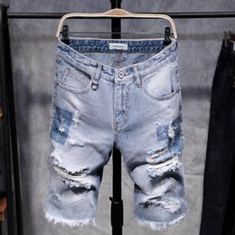 Chinese  Fashion Mens Ripped Short Jeans Hollow Out Bermuda Summer Vintage Distressed Hole Shorts Cowboys Knee Length Denim Shorts Male manufacturers