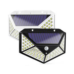 Venta al por mayor de Gran Angular lámparas solares 100leds 1200LM luz solar del jardín llevó el sensor de movimiento PIR Luz solar de la pared Montado