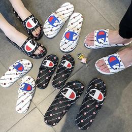 Vente en gros Femmes Hommes Lettre Sandale Été Unisexe Pantoufles Slip Sur Tongs Wedge Plate-Forme Sandales Plage Eau De Pluie Mules Chaussures AAA2228