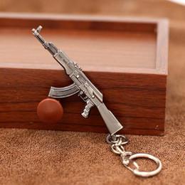 $enCountryForm.capitalKeyWord Canada - 2018 New Game Novelty Items Guns Keychain Pendant Trinket Sniper Key Chain 10 Styles Jewelry Souvenirs Gift Men