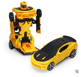 Cars Wholesale Prices Australia - low price Universal electric deformable toy car model plastic Light music toy car children's toy for kids gift can be Robot man