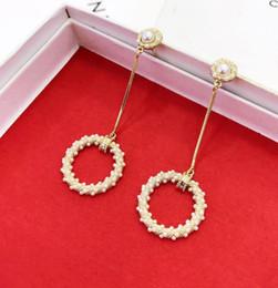4d1be4aa518c Mujer joyas de verano pendientes salvajes 925 pendientes de plata esterlina  perla torcedura elegante anillo de temperamento pendientes pendientes regalo