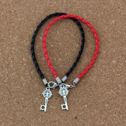 China 50pcs lots leather bracelet Antique silver Saint Benedict Medal Cross Key Religious Charms Pendants Bracelet(red & black) B-351 supplier leather cross pendant suppliers