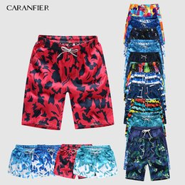 fb2564130a86 Caranfier Men s Sports Short Beach Shorts Bermuda Board Shorts Surfing  Swimming Boxer Trunks Bathing Suits Swimwear Swimsuits C19041001